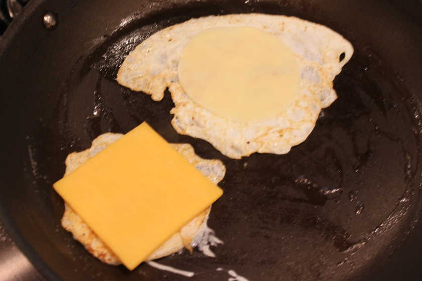 Frying eggs topped with cheese