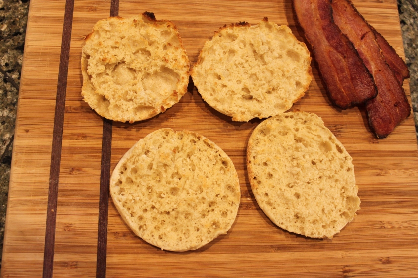 Toasted English muffins with a side of Hempler's bacon