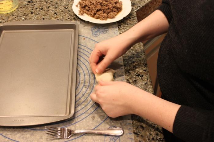 Folding beef into dough
