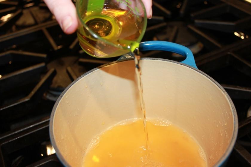adding apple juice to glaze