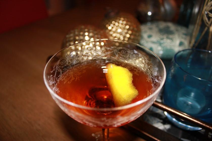 martinez cocktail with a twist of lemon