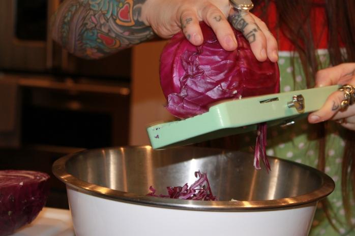slicing purple cabbage on mandolin