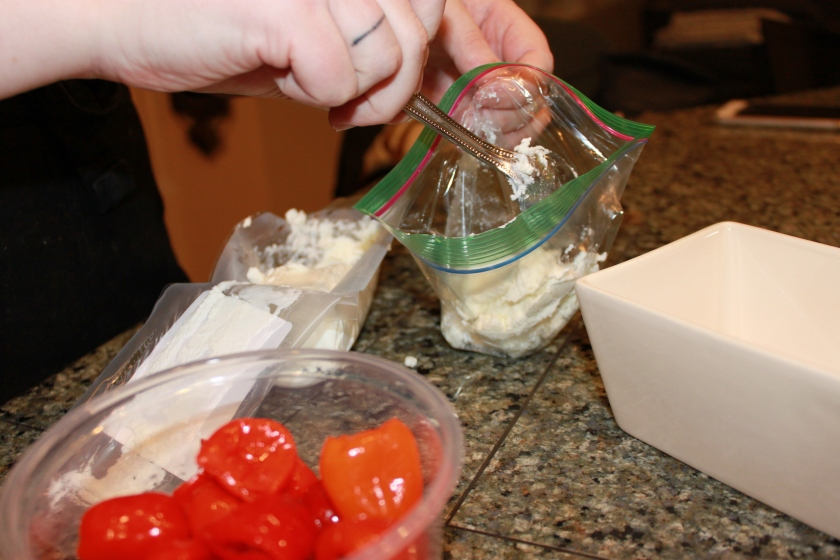 goat cheese into a bag for piping