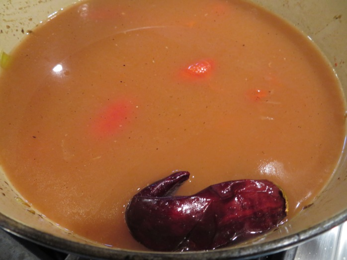 soup cooking with guanjillo pepper